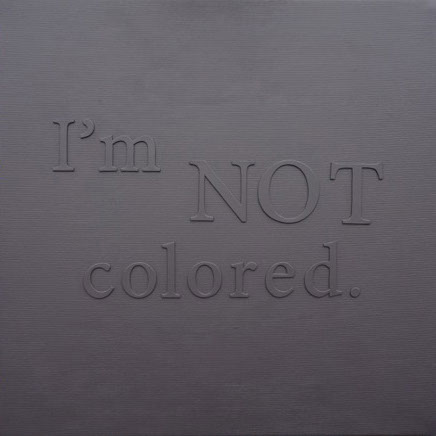 I'm not colored. Black painting, phrase on canvas.