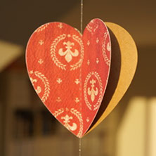 handmade paper mobiles, different prints, made in Switzerland, heart-shaped paper mobiles