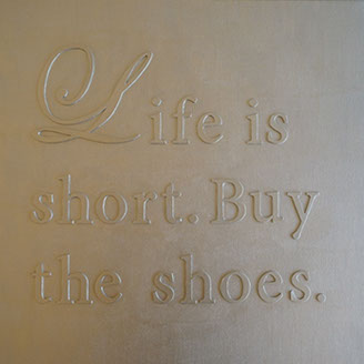 Life is short. Buy the shoes. Silver painting, phrase on canvas.